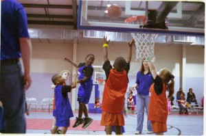 Children enjoying team based drills for basketball (Source: tinkerbrad)