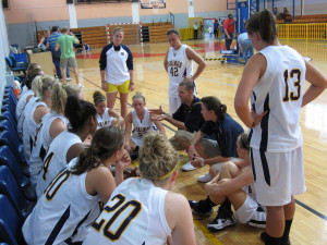 A pre-game team talk might not always be in a locker room. A coach must still be able to communicate to players even under less then perfect situations (Photo Source: quillons)